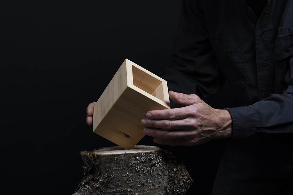 Noah holding a unique custom made box
